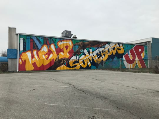 The mural covers 60 feet of the Wheeler-Dowe Boys & Girls Club.