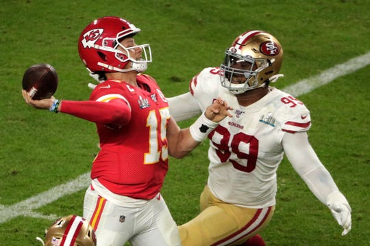 DeForest Buckner (99) closes in on Kansas City Chiefs quarterback Patrick Mahomes (15) in a Feb, 2, 2020 game. Buckner, now a colt, played and started all 19 regular and postseason games for the San Francisco 49ers last season. He's one of several durable players the Colta have acquired this season.