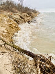 Waves from Lake Michigan crash up against the Beverly Shores lakefront.