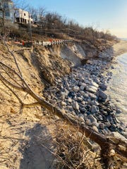 Waves from Lake Michigan are carving away earth underneath a road and parking lot in Beverly Shores, Ind. All the rocks visible were previously buried in sand with a beach that stretched at least 50 feet before the water's edge. That road and lot are now closed, and there are concerns the infrastructure under the road carrying water and gas to homes is at risk as well.