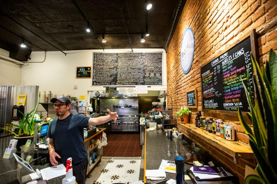 Nodo manager Josh Silver stands behind the counter while taking orders, Monday, March 16, 2020, at their 5 S Dubuque Street store in downtown in Iowa City, Iowa.