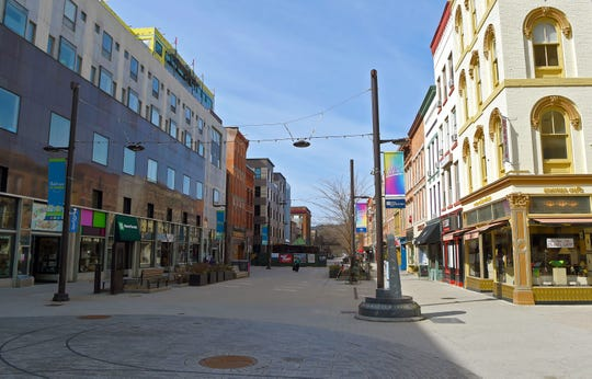 Ithaca Commons is nearly empty as COVID-19 prompts closures in Ithaca and Tompkins County. Monday, March 16, 2020.