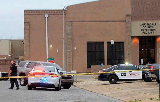 Police block off streets following the shooting of Lauderdale County Chancery Court Judge Charles Smith outside the Lauderdale County Courthouse, in Meridian, Miss., on Monday, March 16, 2020.  Smith was shot and critically wounded in the parking lot outside the courthouse.