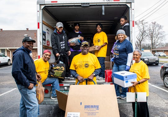 Volunteers at NAACP in Jackson, Tenn., Monday, March 16, 2020  load a truck with supplies such as water bottles, books, laundry supplies and toilet paper for those who were affected by the tornado in Nashville.