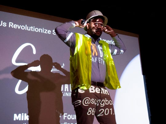 """Mike Benn in a hardhat and vest to pitch Soundboarding, a start-up that produces workplace safety training songs, at the """"What's the Big Idea?"""" pitch competition at Scruffy City Hall on Sunday, March 1, 2020."""