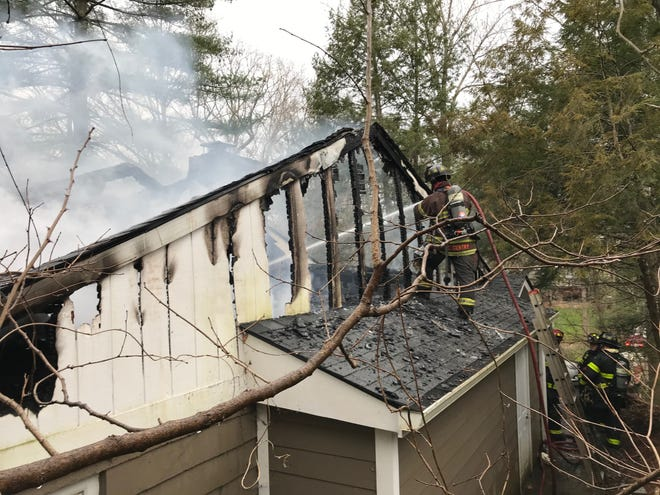 Knoxville firefighters battle a house fire that claimed the lives of two men on Valencia Road in Sequoyah Hills on Saturday, March 14, 2020.