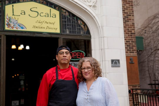 Francisco and Kirsten Serrano, owners of La Scala, pose for a photo outside their Main Street restaurant, Monday, March 16, 2020 in Lafayette.