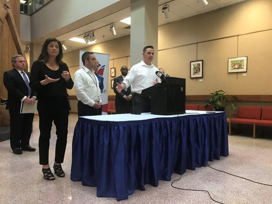 Lafayette Mayor-President Josh Guillory, right, and other officials give an update on coronavirus and safety measures being taken in the parish on March 16, 2020, at City Hall.