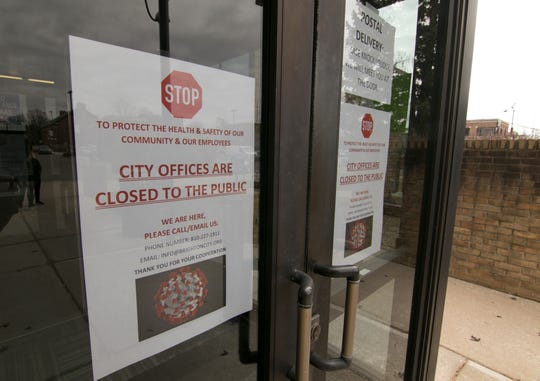 Brighton City Hall personnel posted a sign indicating its closure Monday, March 16, 2020 due to the coronavirus.