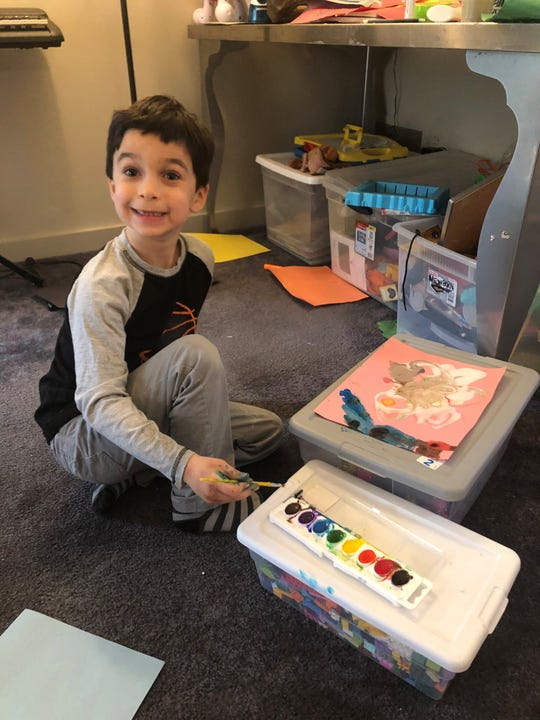 Ari Bornstein, 6, paints to keep active while school is closed for the coronavirus. His mom, Michelle Bornstein, has come up with several ways to keep her children entertained during the pandemic.