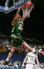 DAYTON, OH - MARCH 17:  Gabe Norwood # 5 of the George Mason Patriots dunks during the game against the Michigan State Spartans in the First Round of the 2006 NCAA Men's Basketball Tournament at the University of Dayton Arena March 17, 2006 in Dayton, Ohio. George Mason won 75-65.