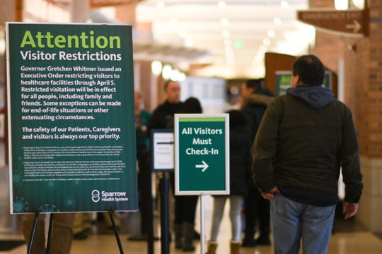A security checkpoint near the emergency entrance of Sparrow Hospital, Monday, March 16, 2020, where Sparrow health professionals screen anyone entering the hospital. Per Gov. Gretchen Whitmer's executive order that all health care facilities must screen visitors and staff for symptoms of COVID-19.
