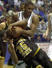 Michigan State's Andre Hutson steals the ball from Alabama State's Joey Ball on Friday, March 16, 2001, in the first round of the NCAA tournament.