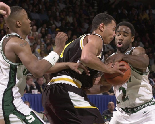16 Mar 2000:  Mateen Cleeves #12 of Michigan State University tries to steal the ball from Milo Stovall #11 of Valparaiso University during the first round of the NCAA Tournament Midwest Regionals at the Goodman Arena at Cleveland State University Convocation Center in Cleveland, Ohio.