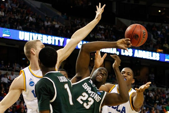 TAMPA, FL - MARCH 17:  Draymond Green #23 of the Michigan State Spartans attempts to control the ball against the UCLA Bruins during the second round of the 2011 NCAA men's basketball tournament at St. Pete Times Forum on March 17, 2011 in Tampa, Florida.