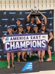 Elgin grad Madison Linstedt, second from right in front row, poses with her freshman teammates after New Hampsire won the America East Women's Swimming and Diving Conference championship.