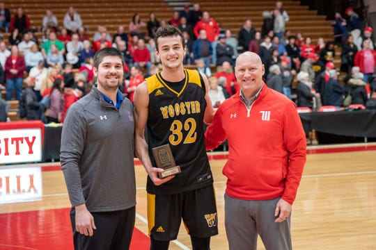 River Valley grad Danyon Hempy, center, receives the Al van Wie Award as the North Coast Athletic Conference Men's Basketball Tournament MVP.