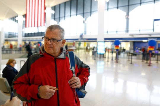 Jean-Claude Bauvais, from Quebec, says he believes the health risks are low as he travels with his family to Fort Lauderdale, Fla., from Memphis International Airport on Monday, March 16, 2020. Airport officials say that travel is down about 50% nationwide from this time last year, likely due to concerns over the spread of the coronavirus.
