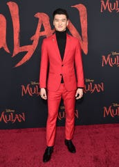 """Chen Tang walks the red carpet at the March 9 Hollywood premiere of """"Mulan."""""""