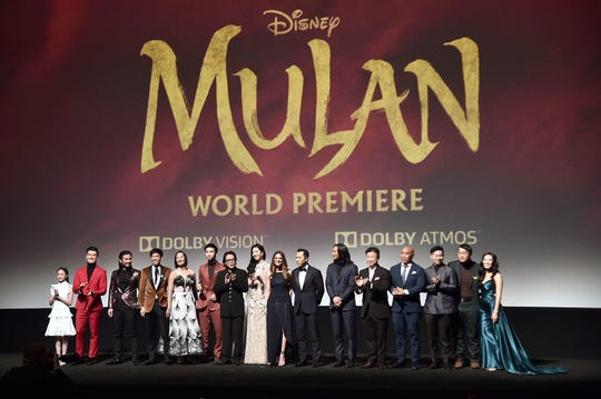 """In his red suit, Chen Tang stood out onstage at the March 9 Hollywood premiere  of """"Mulan,"""" even among such luminaries as Jet Li and title star Yifei Liu."""