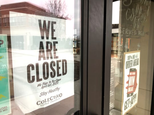 A closed sign is posted on the door of Colectivo Coffee on Mequon Road in Mequon on March 16.  The impact of the coronavirus pandemic is causing numerous closures, layoffs and furloughs in southeast Wisconsin and nationwide. The state Department of Workforce Development logged 160 unemployment claims calls per second on Thursday.