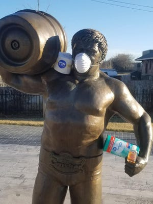Cory Peterson gave Da Crusher statue in South Milwaukee some coronavirus-related accessories on Friday, March 13.