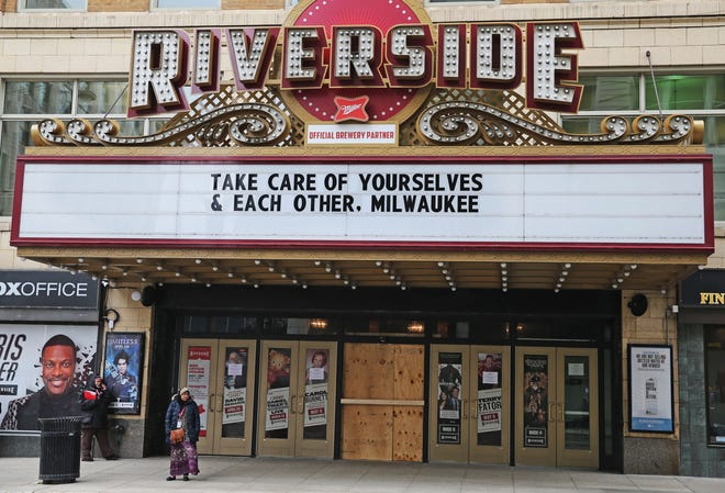 Like so many other businesses and entertainment venues, The Riverside Theater reaches out to the City of Milwaukee through its marquee on Monday, March 16, 2020.