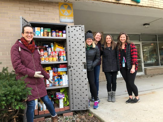 Members of the Kindness Committee at Jefferson Elementary in Wauwatosa stand next to the pantry.