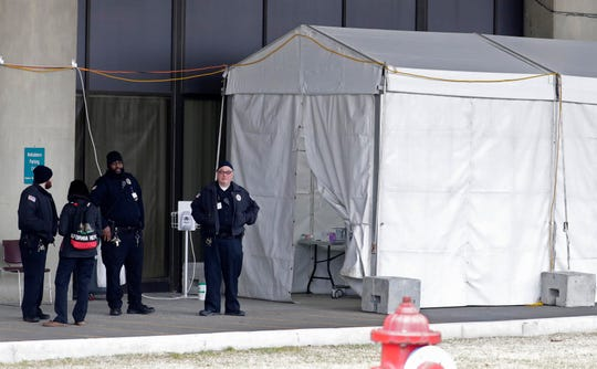 Aurora Sinai Medical Center has set up a tent next to the ambulance bay of its emergency department. A Milwaukee woman says she and her children were told to wait in the tent after a medical worker suspected they could have the virus COVID-19; a doctor saw the family in the tent.