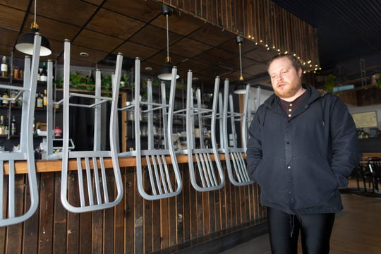 Voyager co-owner Jordan Burich is shown Monday in the south side Milwaukee bar at 422 E. Lincoln Ave. Burich has closed the bar for the foreseeable future after Gov. Tony Evers on Monday banned gatherings of 50 people or more, requiring bars and restaurants to limit their patrons as the state braces for coronavirus to spread through communities.