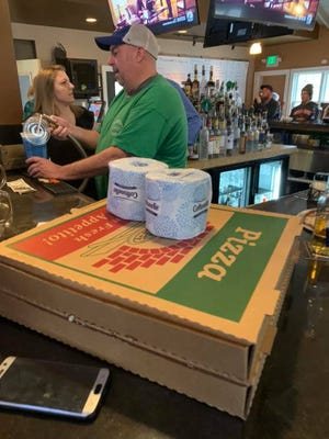 The Mequon Pizza Company is offering a free roll of toilet paper with each pizza purchase.