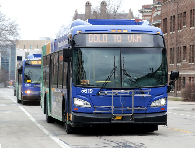 Two Milwaukee County Transit System (MCTS) buses travel on North Downer Avenue in Milwaukee on Monday, March 16, 2020.  The impact of the coronavirus pandemic is causing numerous closures in Southeast Wisconsin and nationwide.