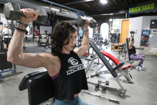 Nicole Goodno of Franklin and Kristen Kalenowicz of Milwaukee, right, working out at the Brickyard Gym, 2651 S. Kinnickinnic Ave., in Milwaukee. They both compete in the Figure and Fit Body competition.