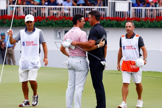 Rory McIlroy (pink) and Brooks Koepka, two of the top three-ranked golfers in the world, have said they will continue to play on the PGA Tour instead of joining the proposed Premier Golf League splinter tour.