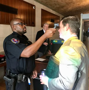 Visitors entering the Louisiana Capitol Monday morning were being screened with temperature checks and questions about their health.