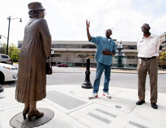 Cont'e Freeman, right, and Eddie Arrington, left, of Walking Man Tours, talks about the lack of tourists since the Coronavirus outbreak in Montgomery, Ala., on Monday March 16, 2020.