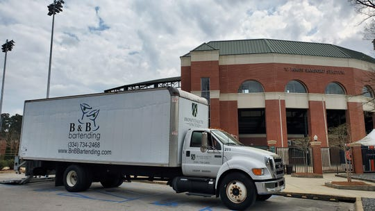A truck carrying unused food and drink from concession stands sits outside Plainsman Park in Auburn on March 16, 2020.