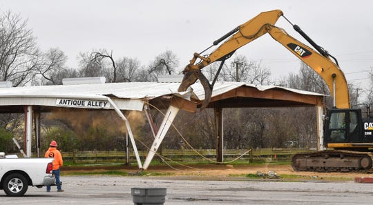 Demolition began March 16 by tearing down an outside shed called Antique Alley at the Nashville Fairgrounds. Over the next few months they plan to take down the sheds first and move the the concrete structures last in Nashville, Tenn. March 16, 2020.