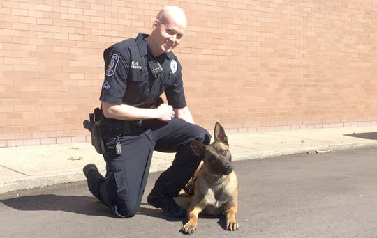 Pax sits with handler Brentwood Police Department field training officer Trey Frasch for a photo Feb. 21, 2020.