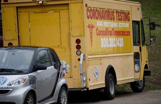 A yellow box truck promoting coronavirus testing, seen in west Nashville Monday, March 17, 2020, is linked to a disgraced doctor who lost his medical license in 2008.