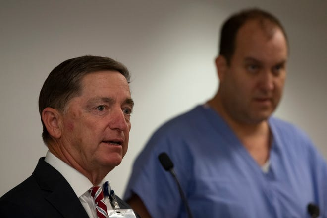 Paul Hiltz, CEO, NCH Healthcare System, left, and Jonathan Kling, RN, Chief Nursing Officer discuss the latest developments with  COVID-19 in Collier County and provide information about their drive-thru testing site during a press conference,, Monday, March 16, 2020, at NCH Telford Library in Naples.