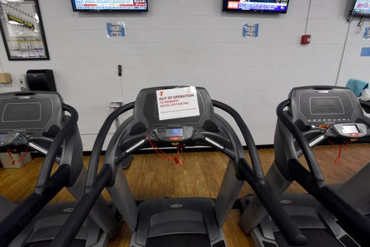 A treadmill marked as out of operation to encourage social distancing at the Licking County Family YMCA. Ohio governor Mike DeWine closed gyms and bowling alleys during a press conference on Monday, March 16, 2020.