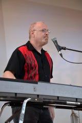 Record staff writer Jim Beckerman, at the keyboards