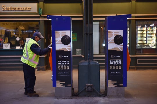 An employee at the Hoboken Terminal disinfects areas around the terminal, which is seeing less traffic during Monday morning's rush hour in Hoboken, N.J. on Monday March 16, 2020. Commuters are working from home due to the coronavirus outbreak.