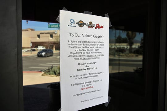 A sign posted to the entrance of the Amador LIVE, a downtown venue consisting of four restaurants and bars, announces its temporary closure in response to the COVID-19 public health emergency on Monday, March 16, 2020.