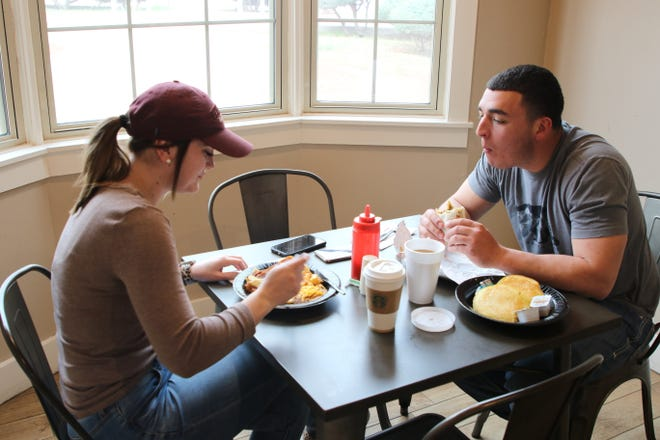 Mara Sternberg and Jonathan Martinez enjoy breakfast March 16, 2020 at PJ and B's Rio Cafe at the Pecos River Village Conference Center in Carlsbad. Co-owner Katelyn Morales said the cafe offers dine in and car side service.