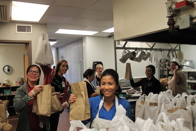 Staff at Yucca Elementary and some Alamogordo Public Schools staff make grab and go meal packs at Yucca Elementary March 16, 2020.  March 16, 2020 marked the first day of canceled classes due to COVID-19 in the Alamogordo Public School District.