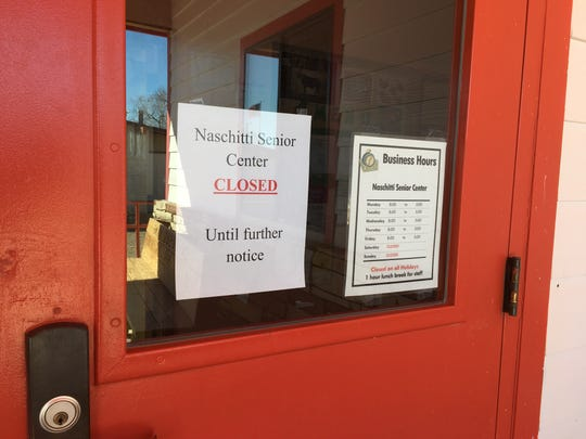 A closure notice is taped to the main door at the Naschitti Senior Center on March 16.