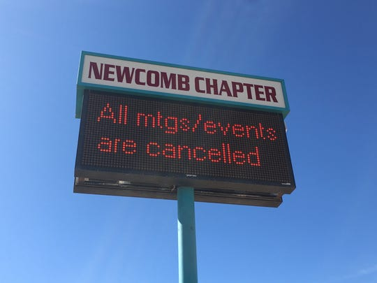 The cancellation of events and meetings at the Newcomb Chapter house is displayed near U.S. Highway 491 in Newcomb on March 16.