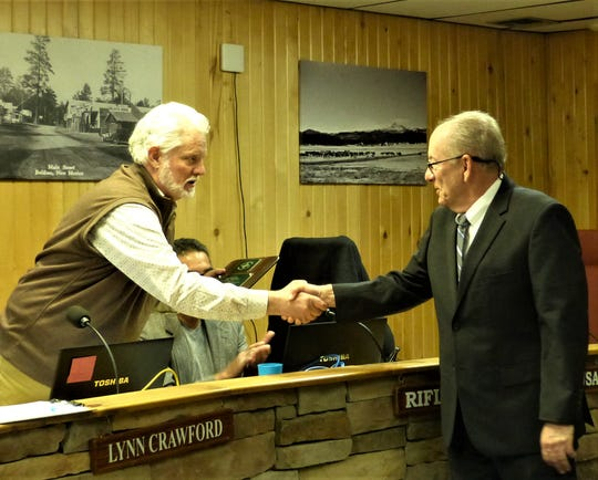 Jeff Kaplan, right, shakes hands with Mayor Lynn Crawford, and said